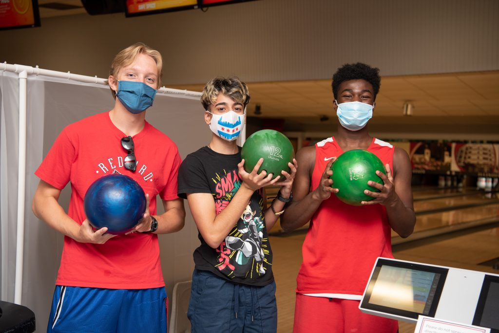Three students pose at the Bowling and Billiards Center