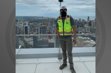 student standing in front of city skyline