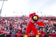 Reggie Redbird in front of the Red Alert student section at Hancock Stadium
