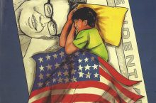 boy sleeping under an United States flag