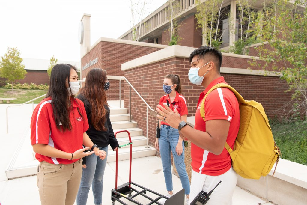 Adrian Micor checks in with the other Admissions guides to find out the majors of the students he is about to give a tour to.