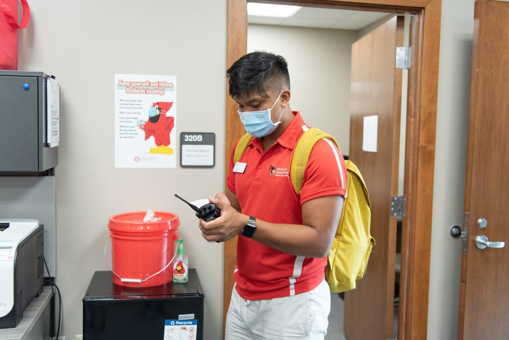 Micor sanitizes his equipment at the conclusion of his shift.