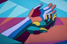 Colorful hands reach out for help