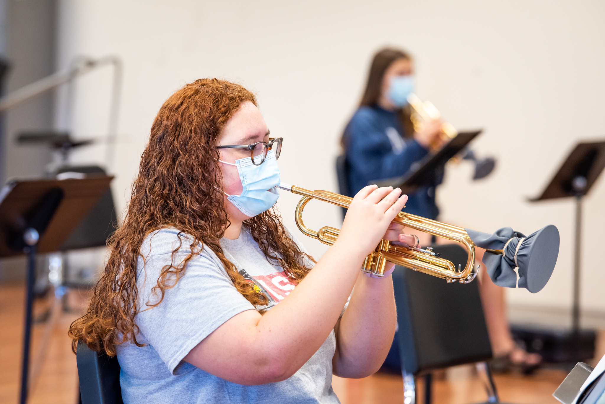 Female students playing horns