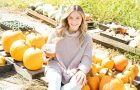 Woman sitting with pumpkins