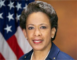 Loretta Lynch with an American flag in the background