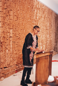 """Tiff Beatty opens The People's Church of the G.H.E.T.T.O with """"Bronzeville Goddamn"""", a spoken word poem, 2019. Photo by Candice Majors."""