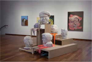 """Installation view of """"A hall of unflattering portraits,"""" MacLaren Art Centre, Barrie, Ontario, Canada, 2019. Work by artist Jason Dunda."""